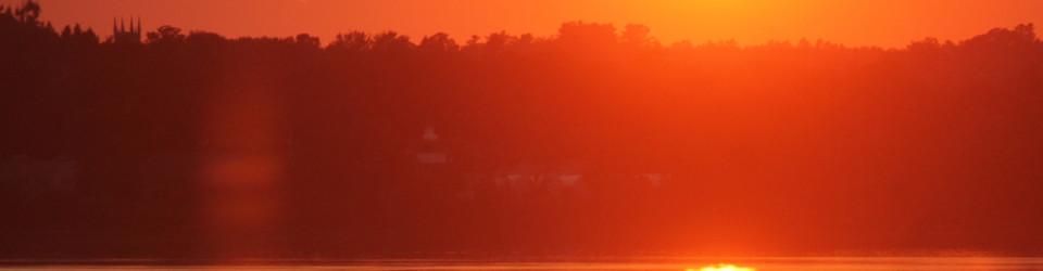 boat through sunset